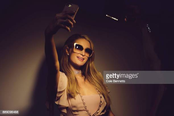 Paris Hilton poses for a selfie during a promotion visit to Australia to launch her 23rd fragrance Rosé Rush on November 30 2017 in Sydney Australia