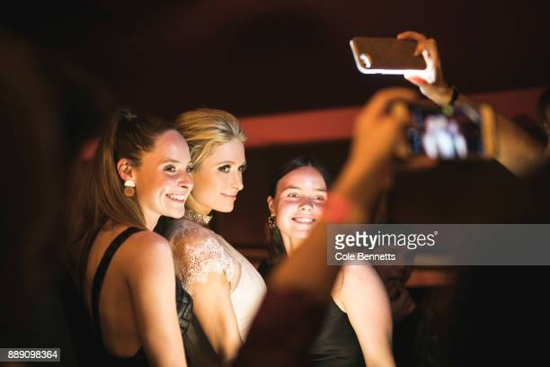 Paris Hilton poses for photos with fans during a promotion visit to Australia to launch her 23rd fragrance Rosé Rush on November 29 2017 in Sydney...
