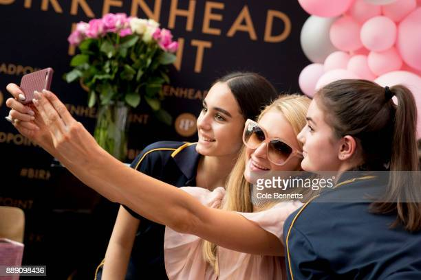 Paris Hilton poses for selfies with fans during a promotion visit to Australia to launch her 23rd fragrance Rosé Rush on November 30 2017 in Sydney...