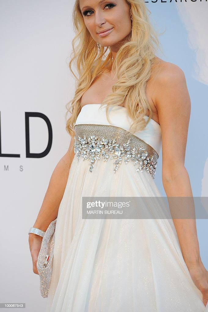 US Paris Hilton poses while arriving at amfAR's Cinema Against Aids 2010 benefit gala on May 20, 2010 in Antibes, southeastern France.