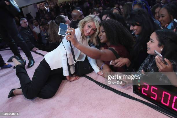 Paris Hilton poses with fans during her panel at Beautycon Festival NYC 2018 Day 1 at Jacob Javits Center on April 21 2018 in New York City