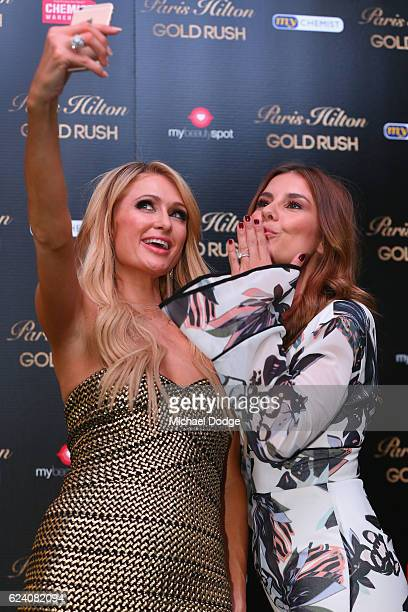 Paris Hilton poses with host Lauren Phillips during a QA with fans at Westfield Doncaster on November 18 2016 in Melbourne Australia