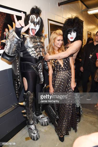 Paris Hilton poses with musicians Gene Simmons and Paul Stanley of KISS backstage at Fashion Rocks 2014 presented by Three Lions Entertainment at the...