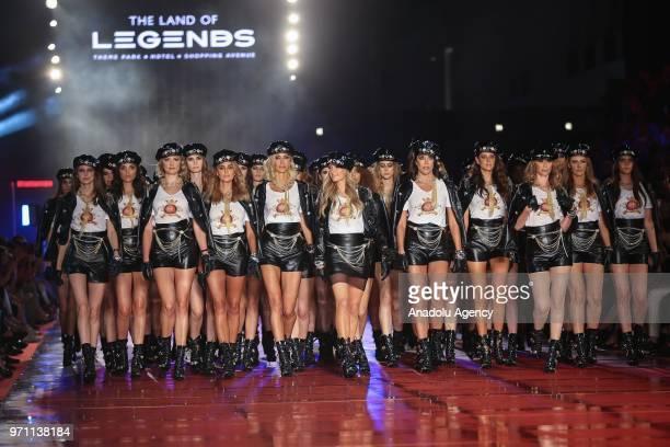 Paris Hilton presents a creation along with Turkish models Cagla Sikel, Deniz Akkaya, Demet Sener, Sebnem Schaefer and Ozge Ulusoy during the Dosso...