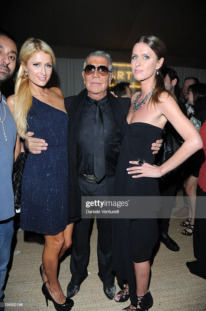 Paris Hilton, Roberto Cavalli and Nicky Hilton attends the 'Carter Cleveland, Wendi Murdoch And Dasha Zhukova Host Party' at Soho Beach House on November 30, 2011 in Miami Beach, Florida.