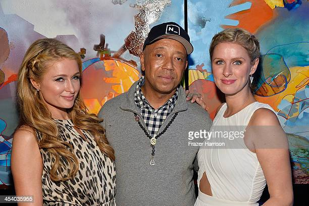 Paris Hilton Russell Simmons and Nicky Hilton attend the Bombay Sapphire artisan series finale dinner hosted by Russell Simmons and Tom Colicchio at...