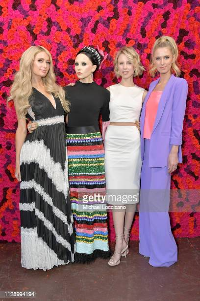 Paris Hilton, Stacey Bendet, Tessa Hilton and Nicky Hilton Rothschild attend the Alice + Olivia By Stacey Bendet presentation during New York Fashion...