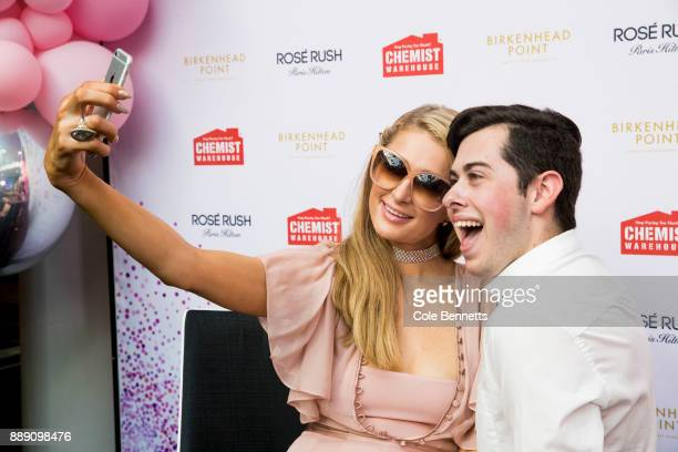 Paris Hilton takes a selfie with a fan during a promotion visit to Australia to launch her 23rd fragrance Rosé Rush on November 30 2017 in Sydney...