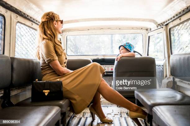 Paris Hilton talks to a little boy who snuck into the drivers seat during a photoshoot and promotion visit to Australia to launch her 23rd fragrance...
