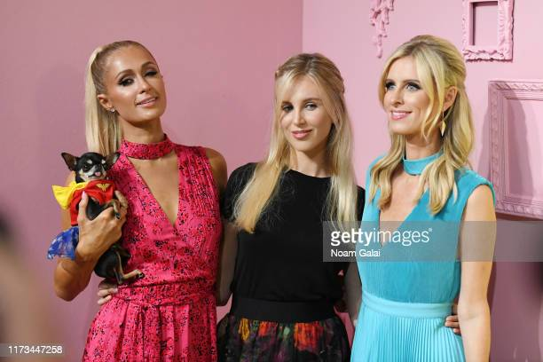 Paris Hilton, Tessa Hilton, and Nicky Hilton attend the Global Fashion Collective II front row during New York Fashion Week: The Shows on September...