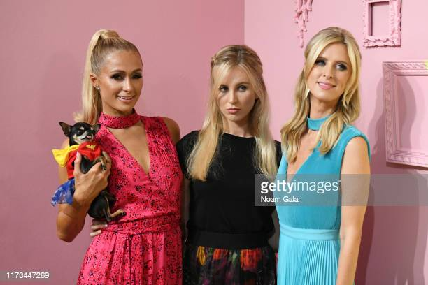 Paris Hilton Tessa Hilton and Nicky Hilton attend the Global Fashion Collective II front row during New York Fashion Week The Shows on September 09...