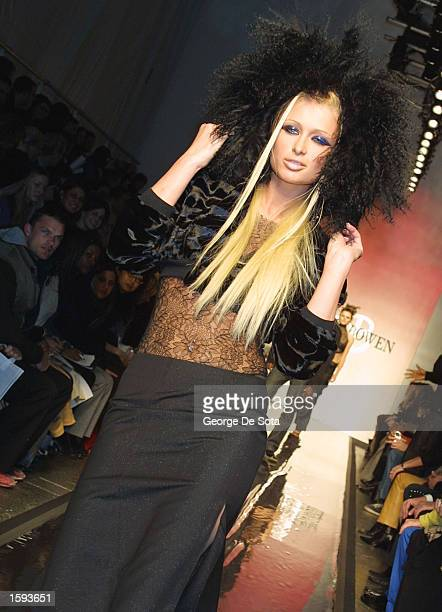 Paris Hilton walks down the runway at the Anne Bowen Fall 2001 fashion show February 12 2001 at Bryant Park in New York City