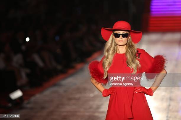 Paris Hilton walks the runway during the Dosso Dossi Fashion Show at The Land of Legends Theme Park in Serik district of Antalya, Turkey on June 10,...