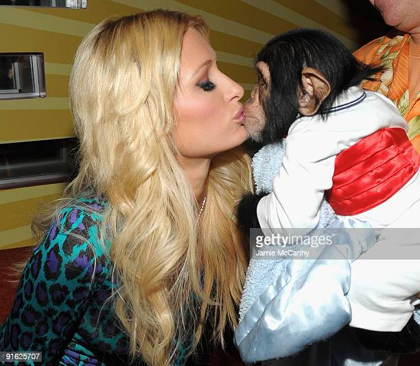 Paris Hilton with Bentley the Chimpanzee attends the opening of Carnival at Bowlmor Lanes on October 8 2009 in New York City