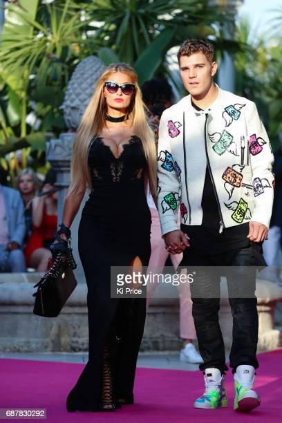 Paris Hilton with boyfriend Chris Zylka walks the runway at Philipp Plein Cruise Show 2018 during the 70th annual Cannes Film Festival on May 24 2017...