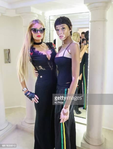 Paris Hilton with Winnie Harlow backstage at the Philipp Plein Cruise Show 2018 during the 70th annual Cannes Film Festival at on May 24 2017 in...