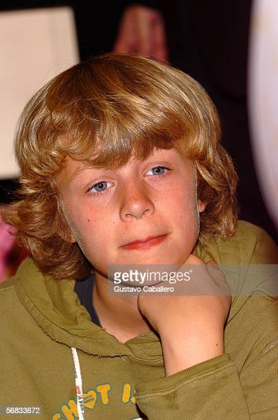 Paris Hilton's brother Conrad looks on at Dadeland Mall where Paris was promoting her perfume February 12 2006 in Miami Florida