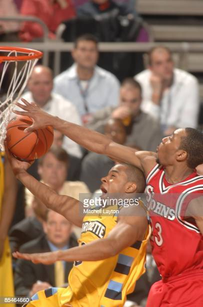 Paris Horne of the St. John's Red Strom blocks a shot during a second round Big East Conference Tournament college basketball game against the...