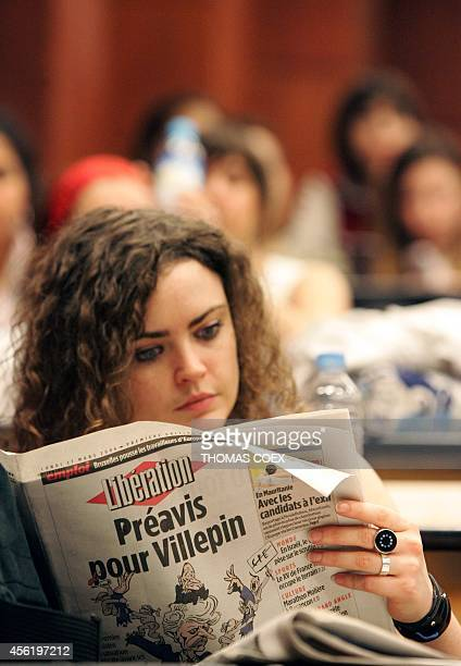A Paris IIISorbonne Nouvelle Censier University's student reads a French newspaper with frontpage that reads 'Notice for Villepin' during a general...