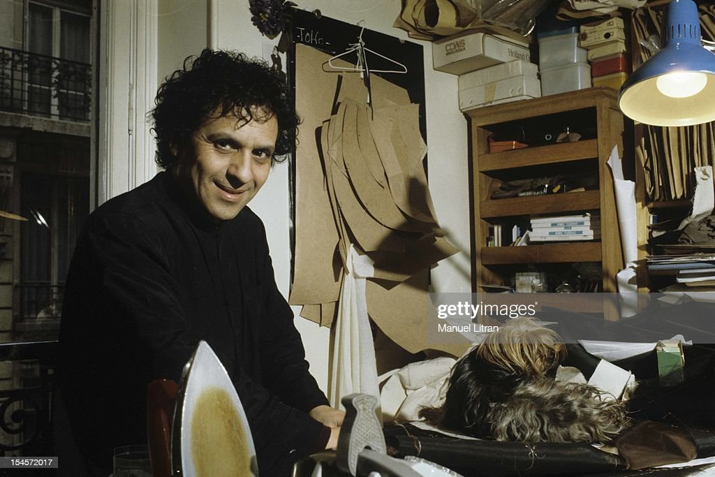 Paris in April 1983, the couturier Azzedine Alaia in his studio, with his chubby dog, a Yorkie .