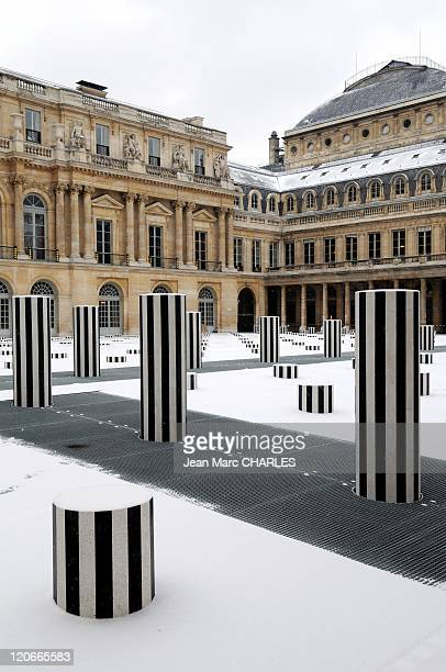 Paris in Snow in France on January 01 2009 The Buren columns at PalaisRoyal These columns of various sizes by the French sculptor Daniel Buren were...