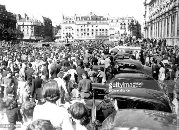 Paris inhabitants in the streets of the French capital after the liberation through American troops German commander Dietrich von Choltitz had given...