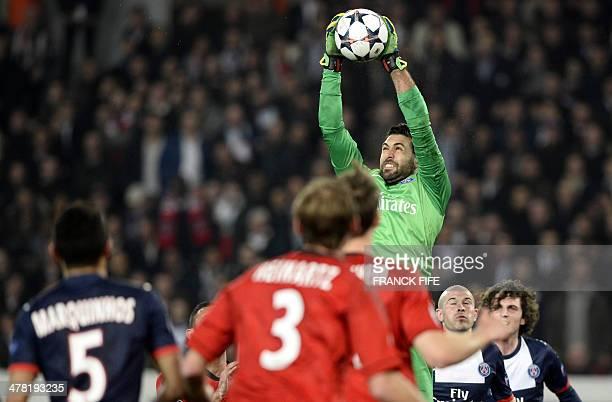 Paris' Italian goalkeeper Salvatore Sirigu catches the ball during the UEFA Champions League last 16 secondleg football match between Paris Saint...