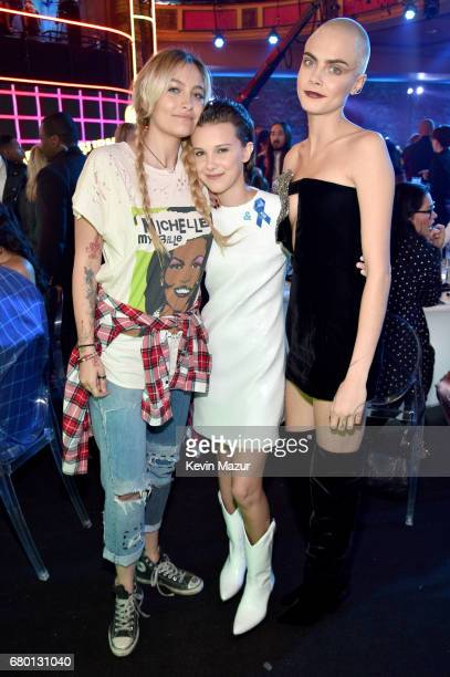 Paris Jackson actor Millie Bobby Brown and actormodel Cara Delevingne attends the 2017 MTV Movie And TV Awards at The Shrine Auditorium on May 7 2017...