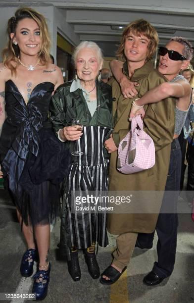 Paris Jackson, Dame Vivienne Westwood, Jordan Barrett and Evan Mock pose backstage at the Vivienne Westwood show during Paris Fashion Week Womenswear...