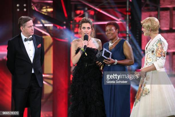 Paris Jackson daughter of Michael Jackson Joyce Jere and Conchita Wurst on stage during the Life Ball 2018 show at City Hall on June 2 2018 in Vienna...