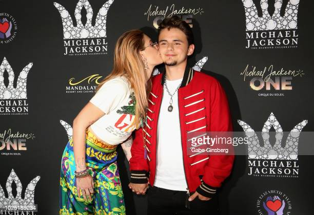Paris Jackson kisses her brother Prince Michael Jackson during the Michael Jackson diamond birthday celebration at Mandalay Bay Resort and Casino on...