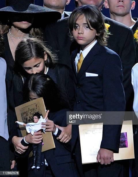 Paris Jackson left Prince Michael Jackson I and Prince Michael Jackson II are shown on stage during the memorial service for Michael Jackson at the...