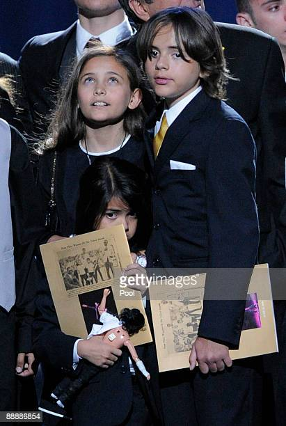 Paris Jackson Prince Michael Jackson I and Prince Michael Jackson II appear onstage during the Michael Jackson public memorial service held at...