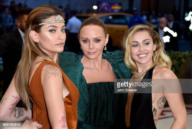 Paris Jackson Stella McCartney and Miley Cyrus attend the Heavenly Bodies Fashion The Catholic Imagination Costume Institute Gala at The Metropolitan...