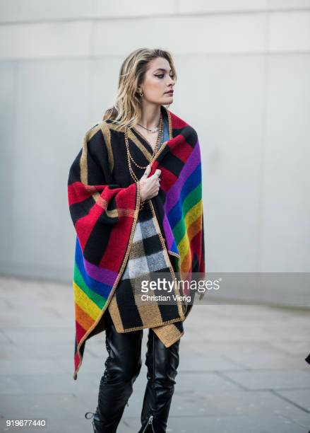 Paris Jackson wearing plaid cape seen outside Burberry during London Fashion Week February 2018 on February 17 2018 in London England