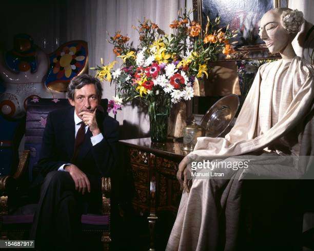 Paris July 1985 Prince Michael of Greece his home in his apartment in the 7th arrondissement sitting in a chair hand under chin a rating of 'a bunch...
