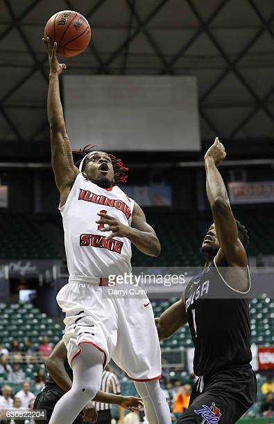 Paris Lee of the Illinois State Redbirds shoots as he jumps to the basket past Martins Igbanu of the Tulsa Golden Hurricane during the first half of...