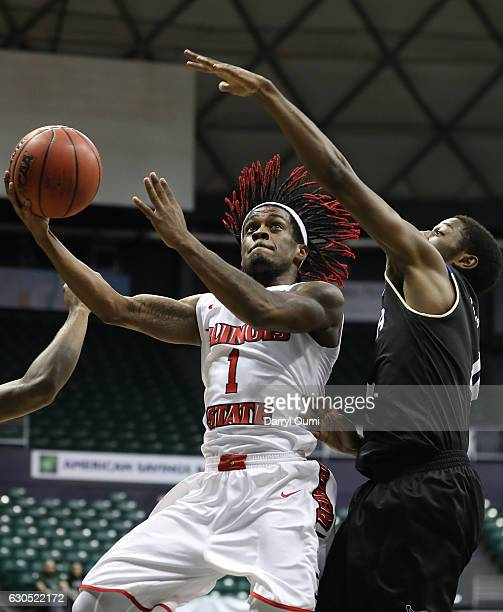Paris Lee of the Illinois State Redbirds shoots over Sterling Taplin of the Tulsa Golden Hurricane during the first half of the Diamond Head Classic...