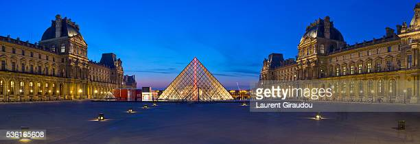 paris, louvre, panned photo - louvre pyramid stock pictures, royalty-free photos & images