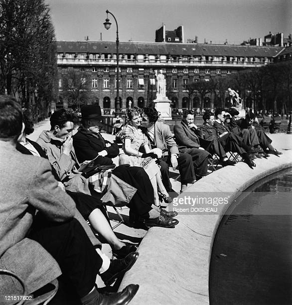 Paris Lovers Kissing In The Public Square Of Palais Royal