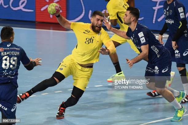Paris' Luka Karabatic takes a shot during the French D1 handball match between Montpellier and Paris at Sud de France Arena on December 21 2017 in...