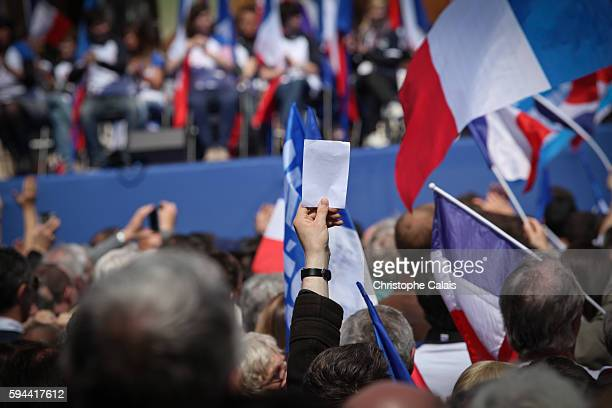 Paris May 1st 2012 Marine Le Pen Front National Mayday parade comemorating Joan of Arc Place de l'Opera in Paris A supporter shows a white vote...