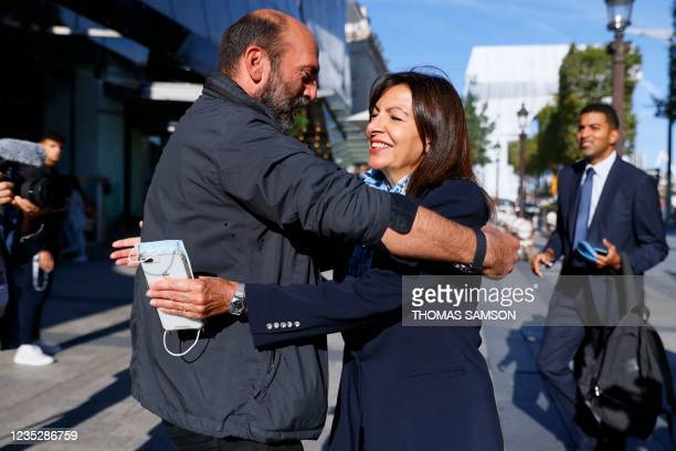 Paris Mayor and Socialist candidate for the 2022 presidential elections Anne Hidalgo greets the nephew of late Bulgarian born artist Christo Vladimir...