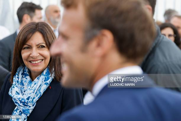 Paris Mayor and Socialist Party candidate for the 2022 French presidential elections Anne Hidalgo and French President Emmanuel Macron attend the...