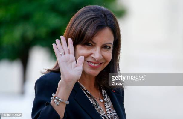 Paris Mayor and Socialist Party candidate for the 2022 French presidential elections Anne Hidalgo waves as she arrives at the Elysee Presidential...