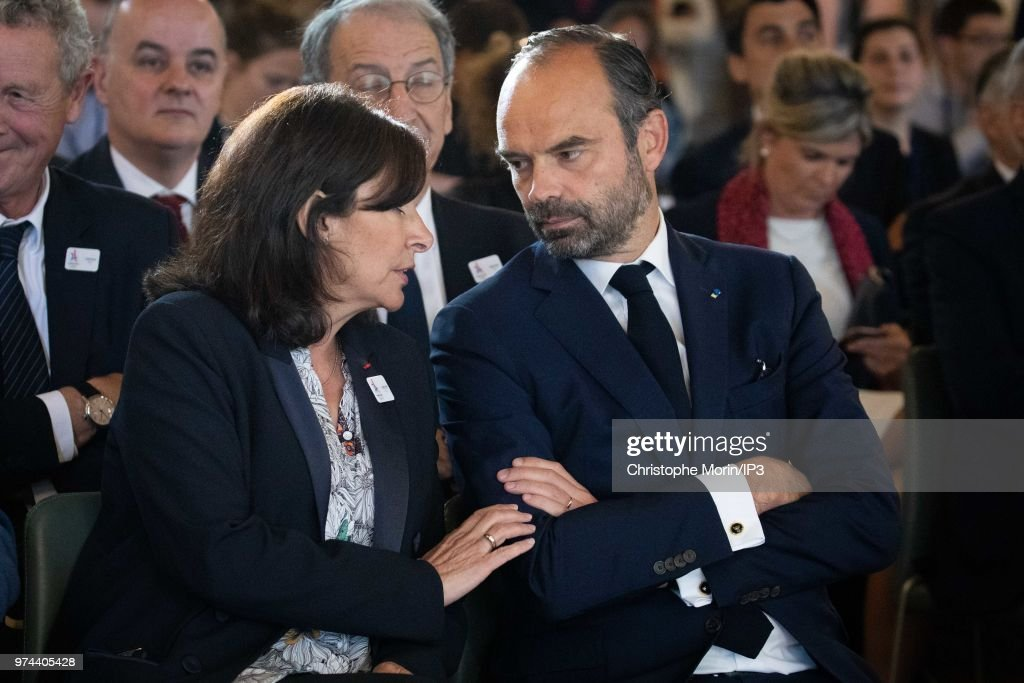 Paris Mayor Anne Hidalgo (L) and French Prime Minister Edouard Philippe (R) attend the ceremony of signing of joint funding protocol for the Paris 2024 Olympic Games and 2024 Paralympics games, at the Paris City Hall on June 14, 2018 in Paris, France. The collective work to optimise the Olympic and Paralympic project was carried out by the Paris 2024 Committee, the State, the local authorities and the various project owners.
