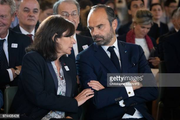 Paris Mayor Anne Hidalgo and French Prime Minister Edouard Philippe attend the ceremony of signing of joint funding protocol for the Paris 2024...