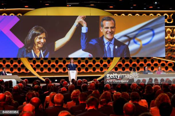 Paris Mayor Anne Hidalgo and Los Angeles Mayor Eric Garcetti are seen on a giant screen during the presentation of LA 2028 before the International...