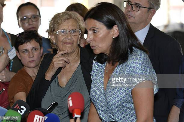 Paris Mayor Anne Hidalgo and Madrid Mayor Manuela Carmena addresse the press after the visit of the future migrants camp construction site on...