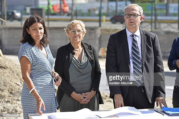 Paris Mayor Anne Hidalgo and Madrid Mayor Manuela Carmena look at the construction plans before the visit of the future migrants camp construction...
